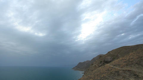 Cloudy sky over the mountains and the sea. Mountain... Stock Video Footage
