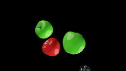 Water splashing apples, alpha Stock Video Footage