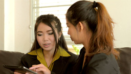 Young Asian Businesswomen Working with a Tablet Computer Footage