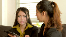 Young Asian Businesswomen Working with a Tablet Computer Stock Video Footage