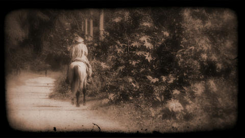 Vintage Film of a person riding a horse Footage
