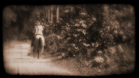 Vintage Film of a person riding a horse Stock Video Footage