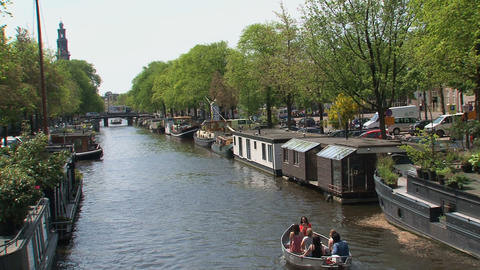 People in a small boat in Amsterdam Stock Video Footage