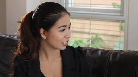 Attractive Asian Lady Talks To A Friend Stock Video Footage