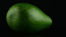 Avocado on black Footage