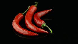 Three red hot peppers Stock Video Footage