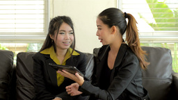 Young Asian Office Workers Discussing Work on a Tablet Computer Footage