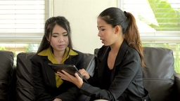 Young Asian Office Workers Discussing Work on a Tablet... Stock Video Footage