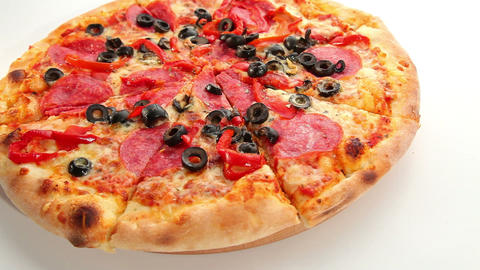 Italian tasty pizza, cheese, salami and olives, do Stock Video Footage