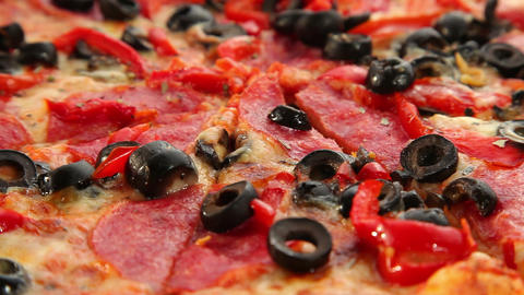 Pizza with cheese, salami and olives, dolly shot Stock Video Footage