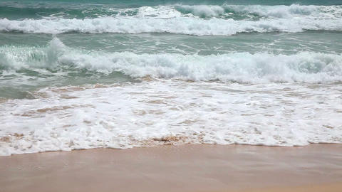 Young girl having fun with ocean waves on beach Stock Video Footage