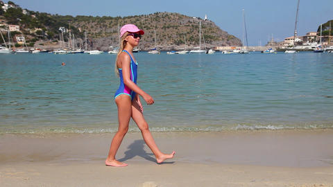 Young Girl Walking On The Beach At Sunny Day stock footage