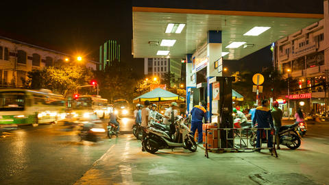 PEOPLE AT A GAS STATION AT NIGHT - SAIGON, VIETNAM Footage