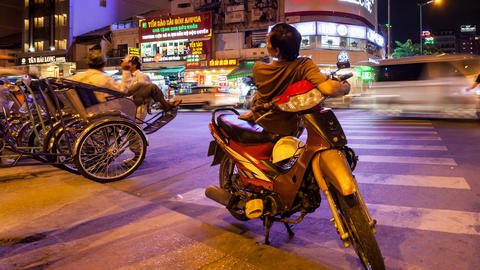 VIETNAMESE MOTO TAXI WAITING FOR CLIENTS - TIME LA Stock Video Footage