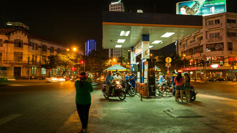 PEOPLE AT A GAS STATION AT NIGHT - SAIGON, VIETNAM Stock Video Footage