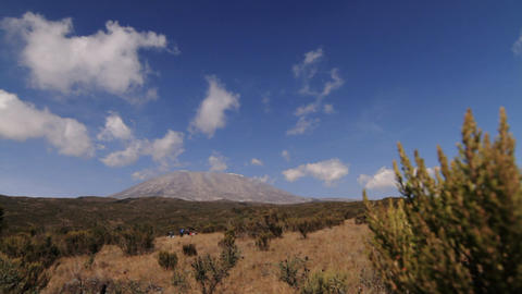 Wide view of Kilimanjaro trekkers in foreground Stock Video Footage