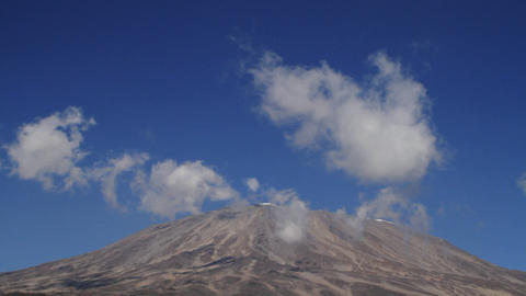 Static shot of Kilimanjaro with clouds moving Stock Video Footage