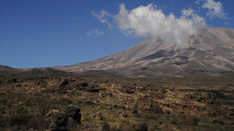 Pan from left to Kilimanjaro summit Stock Video Footage