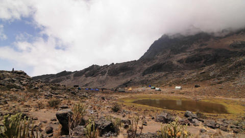 Tilt up to wide shot of Kilimanjaro camp Stock Video Footage