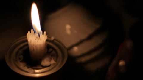 Candle on the table at night Stock Video Footage