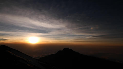 Setting sun with rocky outcrop Stock Video Footage