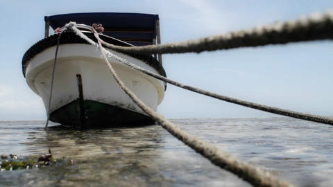 Close up of mooring lines for boat with boat Stock Video Footage