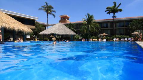 Resort pool people relaxing Stock Video Footage