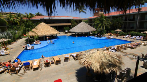 Overlooking resort pool Stock Video Footage