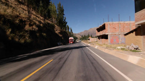 Travelling down the road out of Cusco Stock Video Footage