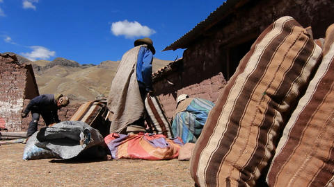 Villagers with potato sacks getting ready Footage