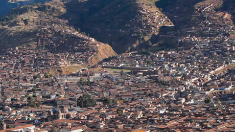 Cusco city in the hills pan across city Footage
