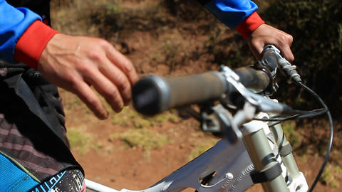 Biking with hands on grip checking breaks Stock Video Footage