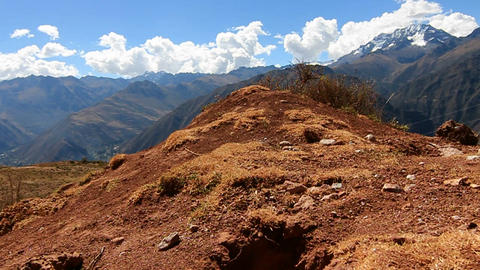 Pan from peak to trail with biker Stock Video Footage