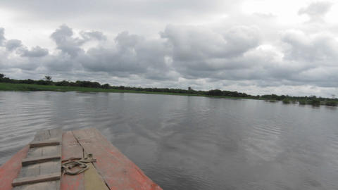 Boat travelling towards village Stock Video Footage