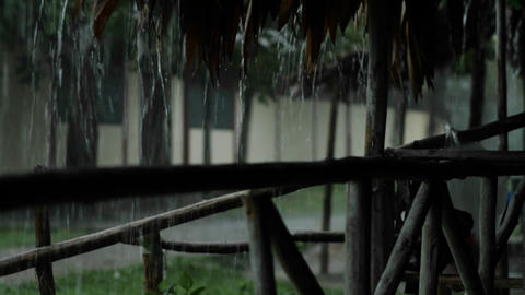 Rain pouring down outside hut Stock Video Footage