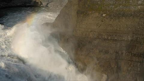 Rainbow over thundering waterfall Stock Video Footage