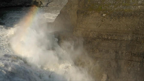 Rainbow over thundering waterfall Stock Video Footage