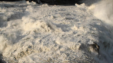 Water flowing over the waterfall crest Stock Video Footage