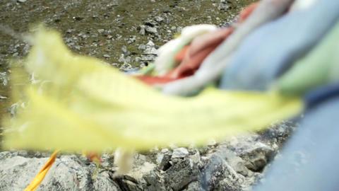Prayer flags streaming off chorten Stock Video Footage