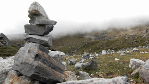 Shot from behind cairn Stock Video Footage