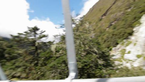 Following a porter across a bridge Stock Video Footage