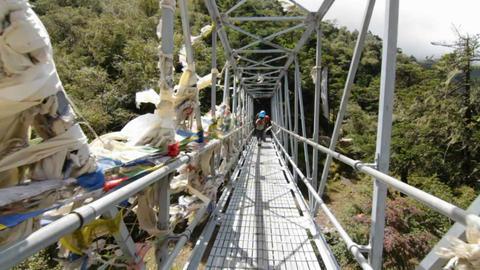 Passing porters on the bridge Stock Video Footage