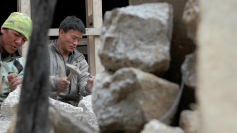 Pan of stone masons chiseling Stock Video Footage