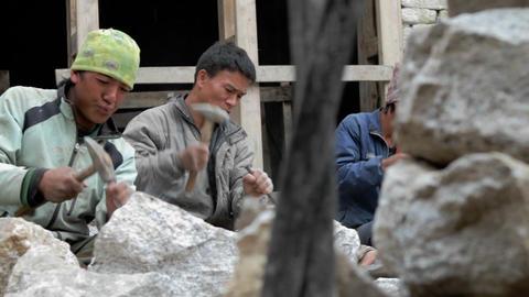 Pan of stone masons chiseling Stock Video Footage