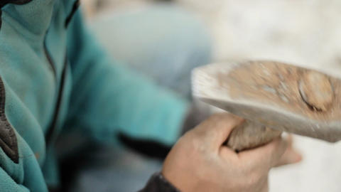 Mason hammering stone, in/out focus Stock Video Footage