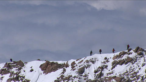 Climbers on west ridge with sea of clouds Stock Video Footage