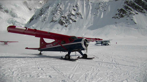 Plane taking off at from glacier Stock Video Footage