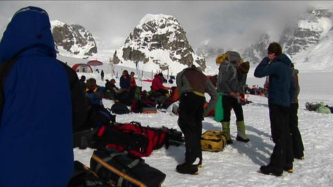 Clambers getting ready, peak behind Denali Stock Video Footage