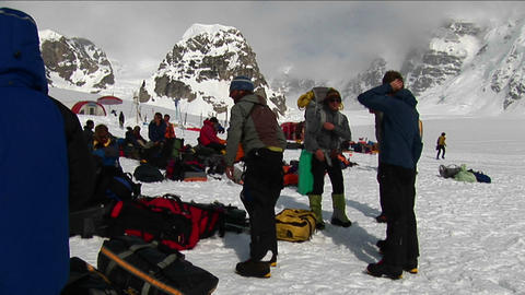 Clambers getting ready, peak behind Denali Stock Video Footage