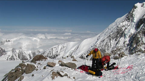 Climbers prepping for climb ahead Stock Video Footage